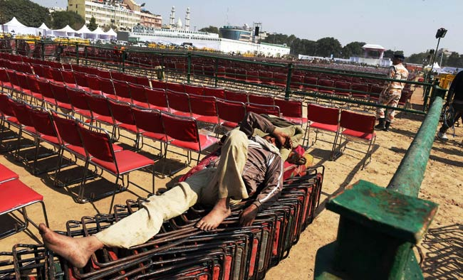 A worker during preparations for of the oath-taking ceremony of Arvind Kejriwal as Delhi Chief Minister, at Ramlila Maidan in New Delhi on Friday. Photo: PTI.