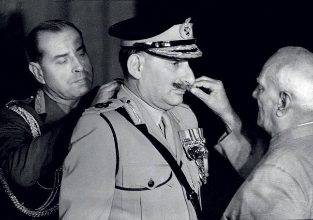 Sam Manekshaw, 1973: President V.V. Giri is appointing the general to the five-star rank of field marshal; the first army chief to receive that title. It looks, of course, as if he is twirling the famous moustache.