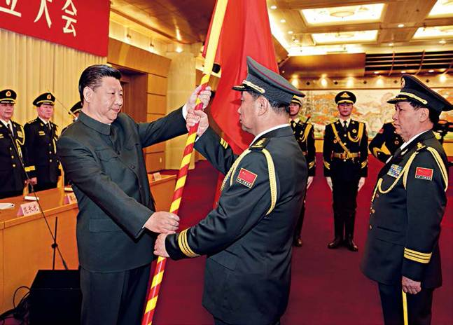 High fly: Xi presents flag to Northern theatre commander Song Puxuan in Beijing.