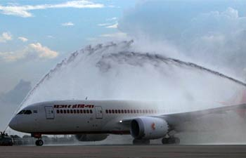 Water cannon salute being given to Boeing 787 Dreamliner