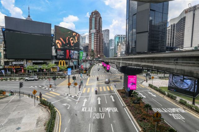 A general view of traffic in Bukit Bintang, Kuala Lumpur as the movement control order kicks in on March 18, 2020. — Picture by Firdaus Latif