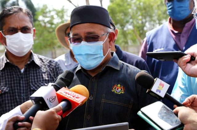 Datuk Seri Tuan Ibrahim Tuan Man speaking to reporters during his visit to Sungai Kim Kim in Johor, March 9, 2021. — Bernama pic