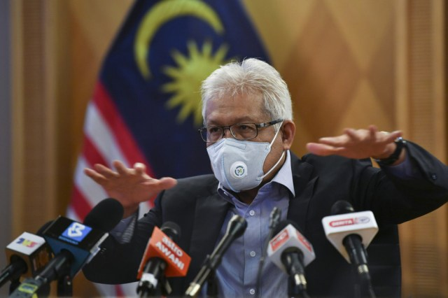 Home Minister Datuk Seri Hamzah Zainudin at a press conference after chairing the Covid-19 Movement Control Order SOP Compliance and Enforcement Coordination Committee meeting in Putrajaya, July 1, 2021. — Bernama pic