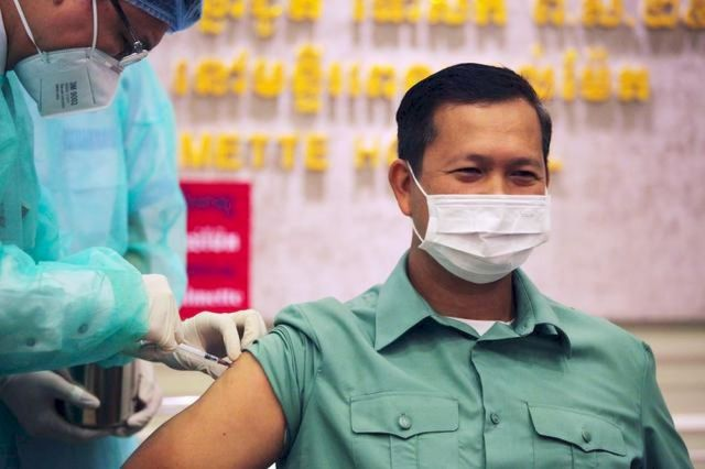 Hun Manet, the son of Cambodia's Prime Minster Hun Sen receives a vaccine as Cambodia starts its Covid-19 vaccine rollout with 600,000 doses of Sinopharm vaccine donated by China in Phnom Penh, Cambodia, February 10, 2021. — Reuter pic