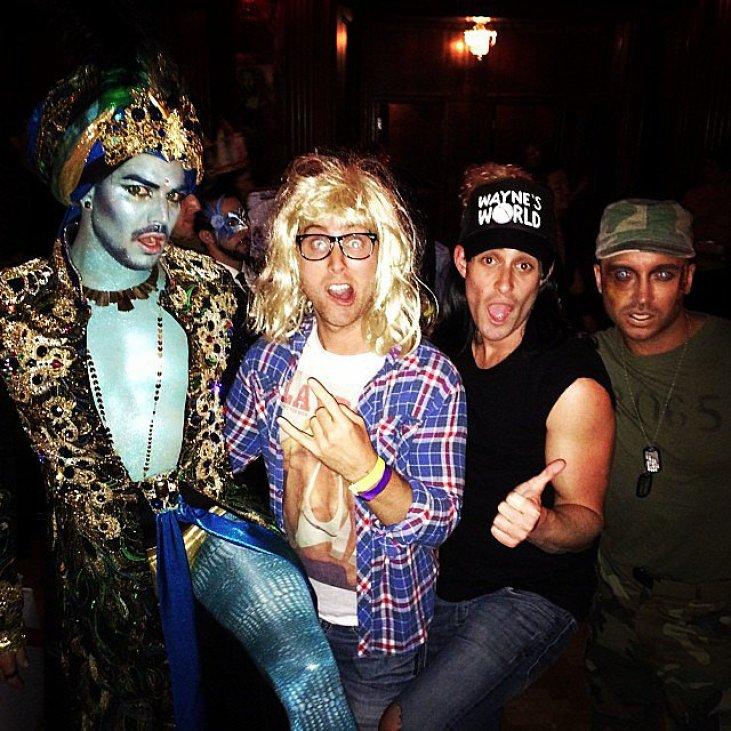 Lance Bass went as Garth from Wayne's World for Halloween, posing alongside Adam Lambert in his genie costume.<br /><br /> Source: Instagram user lancebass<br /><br />