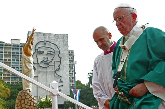 Pope Francis climbs the steps to the altar upon arriving to give the first mass of his visit to Cuba in Havana's Revolution Square, Sept. 20.
