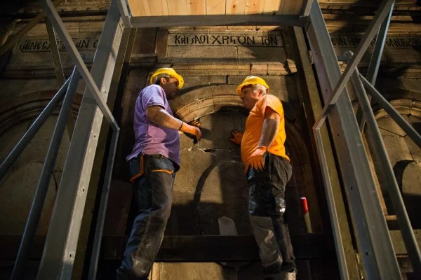Image: Construction workers inside the Church of the Holy Sepulchre in Jerusalem