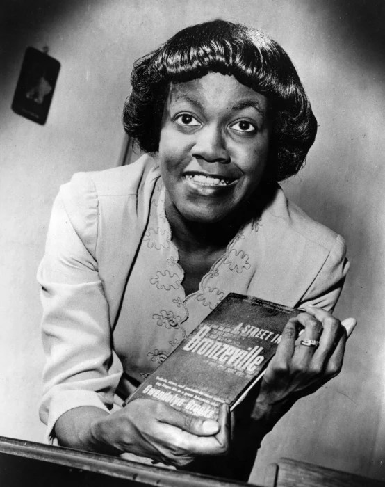 "Image: American writer Gwendolyn Brooks poses with her first book of poems titled ""A Street in Bronzeville,"" 1945, in this undated photo."