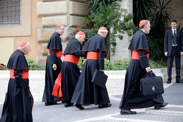 Image: From left, U.S. Cardinals Theodore McCarrick, Roger Mahoney, Francis George, Donald Wuerl and Daniel Di Nardo arrive for a meeting, at the Vatican on March 5, 2013.