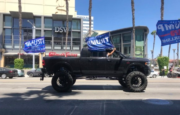 A truck joins a pro-President Donald Trump caravan driving past Black Lives Matter protesters gathered outside Sherman Oaks Galleria in Los Angeles on Sunday.