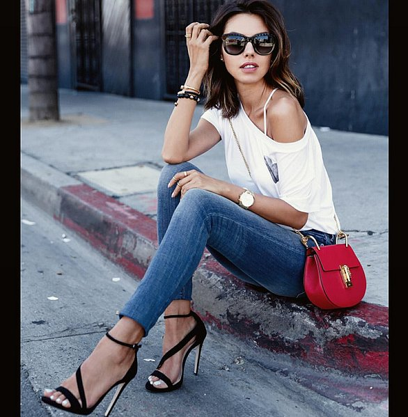 Swept Off the Shoulder With Skinny Jeans and Strappy Sandals