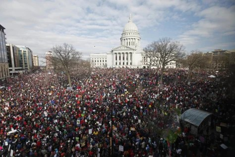Image: Massive crowds gather at the Wisconsin State Capitol in Madison