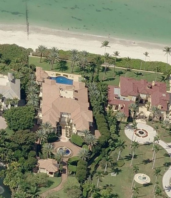 Image: The $19 million house shown at left in Naples, Florida, has been moved out of the highest-risk flood zone by FEMA