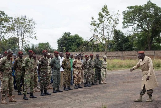 Image: National Army soldiers listen during a registration briefing for the induction of soldiers at a temporary military base in the capital of Bangui