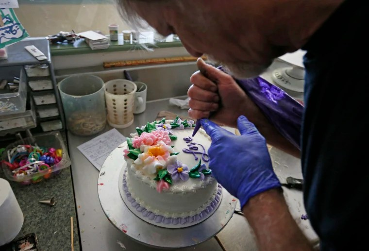 Court Rules Baker Can t Cite Religion to Deny Cakes for Gay Couples Masterpiece Cakeshop owner Jack Phillips decorates a cake inside his store   in Lakewood  Colorado  in 2014 Brennan Linsley   AP file
