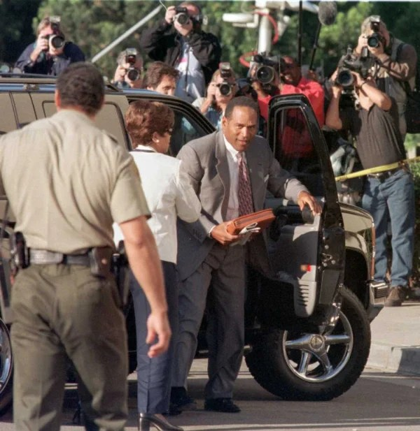 Defendant O.J. Simpson arrives under the gaze of t