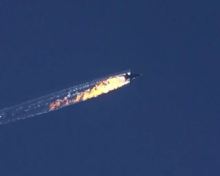 Image: A burning trail as a plane comes down