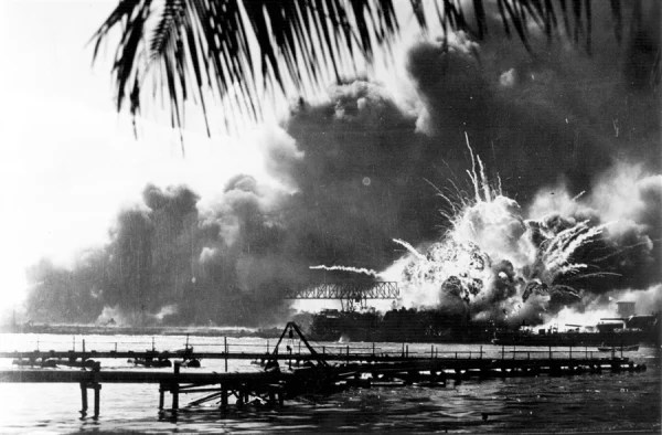 Image: The American destroyer USS Shaw explodes during the Japanese attack on Pearl Harbor.