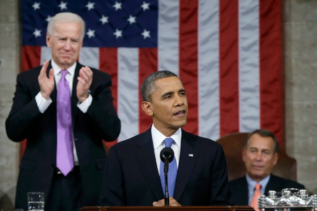 Joe stands to applaud Barack during the State of the Union. February, 2013.