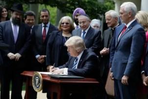 Image: Donald Trump signs an executive order