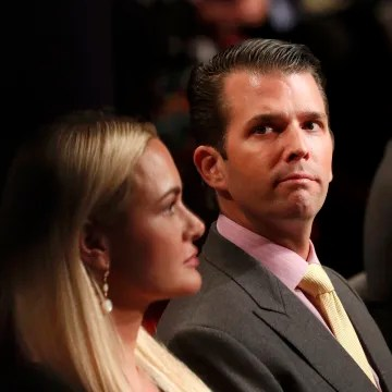 Image: Donald Trump Jr. sits between his wife Vanessa and his brother Eric during the third and final debate between Republican U.S. presidential nominee Trump and Democratic nominee Clinton in Las Vegas