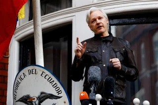 Image: WikiLeaks founder Julian Assange speaks on the balcony of the Ecuadorian Embassy in London