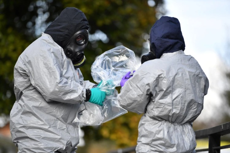 Image: Officials bag samples after swabbing railings near the Maltings shopping center