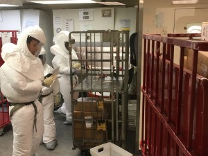US Defense Department personnel, wearing protective suits, screen mail at the Pentagon in Washington, DC on October 2, 2018.Mosheh Gains / NBC News