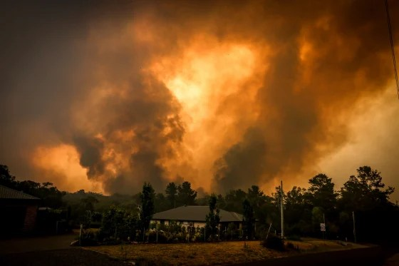 Image: Fires approach a home in the outskirts of Bargo, near Sydney, on Dec. 21, 2019.