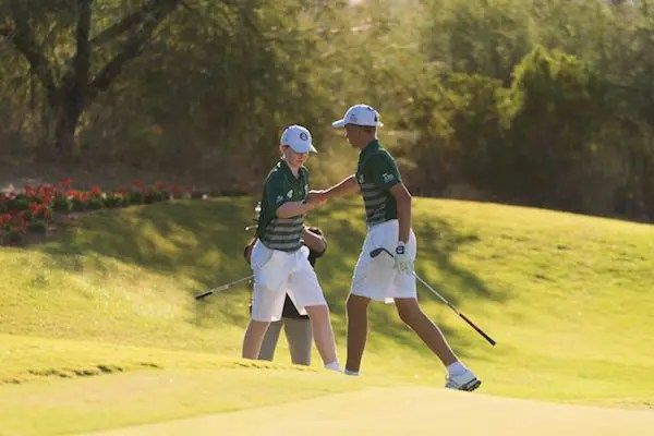 Colin Keith of Team California fist bumps Curtis Da Silva of Team California on the eighth hole at the Blue Course during Session Five for the 2019 PGA Jr. League Championship presented by National Car Rental held at the Grayhawk Golf Club on October 14, 2019 in Scottsdale, Arizona. (Photo by Darren Carroll/PGA of America)