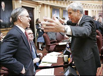 Senate Minority Leader Thomas K. Norment Jr. (R-James City), left, talks with Majority Leader Richard L. Saslaw (D-Fairfax) in Richmond. Saslaw says immigration bills that are punitive will face hurdles in the Senate.
