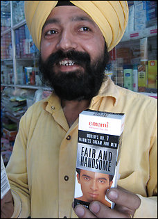 Shopkeeper Gurdip Singh says skin-lightening creams are big sellers, though at about $1, they're half a day's wages for some. Still,