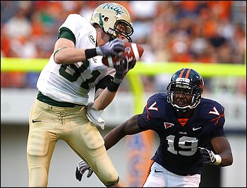 William & Mary receiver Cameron Dohse hauls in a catch in front of cornerback Ras-I Dowling during the I-AA Tribe's season-opening upset of Virginia, which failed to score in the second half. (By Andrew Shurtleff -- Associated Press)
