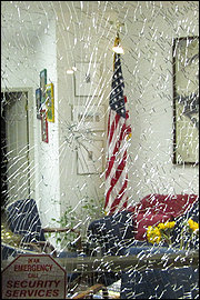 Damage caused by vandalism at the office of U.S. Rep. Gabrielle Giffords (D-Ariz.).