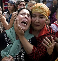 Uighur women grieve for men they say were taken by authorities in a protest in Urumqi, China, last year.