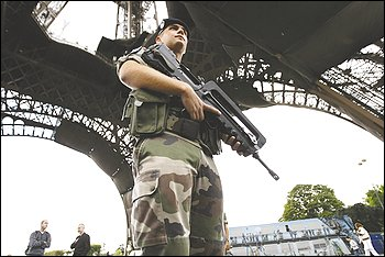 A French soldier patrols at the Eiffel Tower in Paris. President Nicolas Sarkozy's government has gone out of its way in recent days to warn repeatedly that terrorists may be planning a new attack in France.