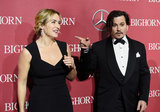 Johnny Depp e Kate Winslet hanno la Riunione incredibilmente affascinante del tappeto rosso