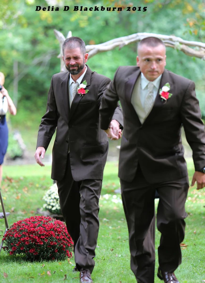 Todd Bachman and Todd Cendrosky shared father-of-the-bride duties and walked Brittany Peck down the aisle