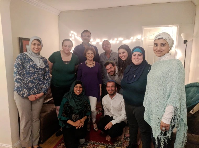 Image: Rivka Cohen,third from right, with Jewish and Muslim guests who gathered at her home for an Iftar and Sabbath meal