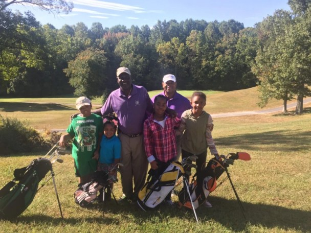"""Image: Craig Kirby, back right, with participants in """"Golf. My Future. My Game."""""""