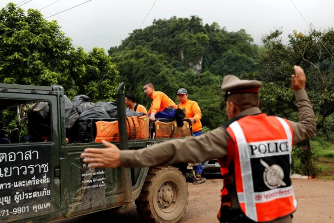 Image: Rescue workers are seen near the Tham Luang cave complex, where 12 schoolboys and their soccer coach are trapped inside a flooded cave, in the northern province of Chiang Rai