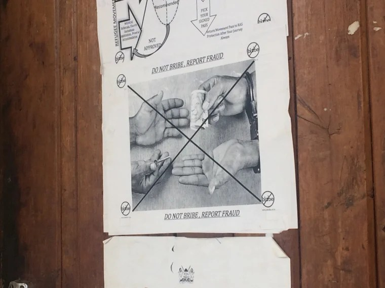 Image: A poster on the wall of UNHCR's headquarters in the Kakuma refugee camp warns refugees not to bribe and to report fraud instead.