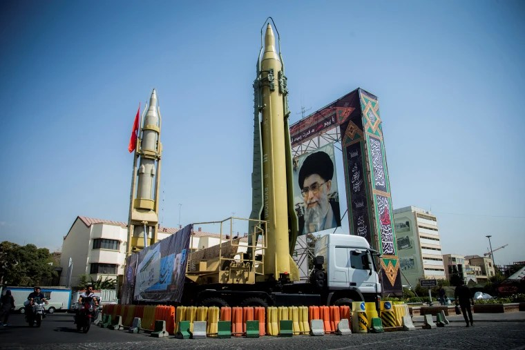 A display featuring missiles and a portrait of Iran's Supreme Leader Ayatollah Ali Khamenei