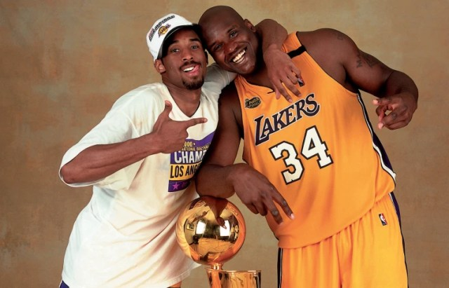 Image: Kobe Bryant and Shaquille O'Neal of the Los Angeles Lakers pose with the NBA Championship trophy at the Staples Center in 2000.