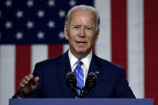 Biden, citing briefings, says Russia again working to interfere with the election