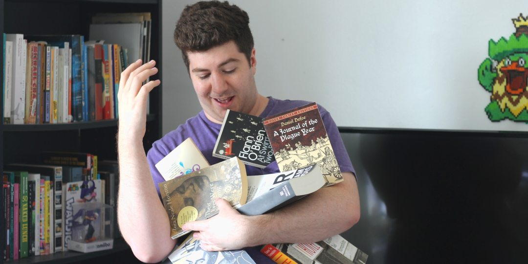 me struggling to hold all the books I'm not reading