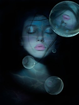 Image ID: BLD0140518 Mixed race woman's face reflected in bubbles