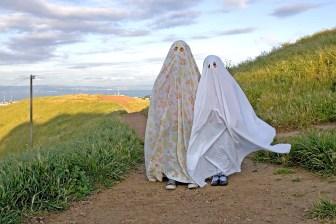 Media Bakery ID: MSC0000870 Children wearing ghost costumes on dirt road