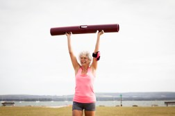 Middle age woman exercising in park --- Image by © JAG Images/Corbis