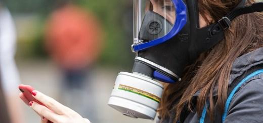 Gas mask, woman journalist